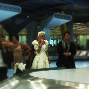 Runaway bride waiting for her luggage